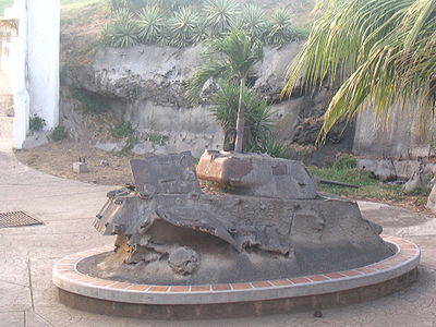 "Cement-covered tank in Chamorro's Peace Park (Parque de Paz) symbolizing the wish of Nicaraguans that their country ""never again"" be plagued by such violence. Peace park tank krk.jpg"