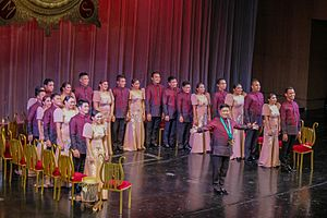 "University of the Philippines Madrigal Singers - The Philippine Madrigal Singers acknowledges the audience at the end of their homecoming concert ""Trionfo"" (8 October 2016) at the Main Theater (Tanghalang Nicanor Abelardo of the Cultural Center of the Philippines. Standing at the center is choirmaster Mark Anthony Carpio."