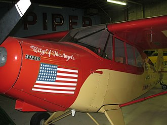 "Piper PA-12 - The ""City of The Angels"" which flew around the world in 1947 on display in the Piper Aviation Museum in Lock Haven, Pennsylvania"