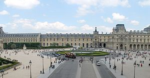 Place du Carrousel - Place du Carrousel from the southern wing of the Louvre Palace. The Arc de Triomphe du Carrousel is on the left