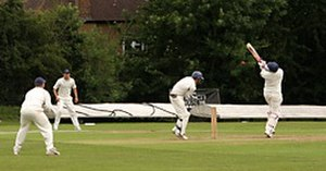 Bouncer (cricket) - A batsman attempting to play a hook shot against a bouncer.