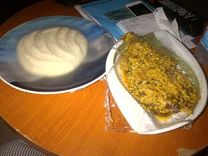 Egusi - Pounded Yam and Egusi Soup served with fish
