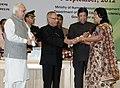 Pranab Mukherjee presenting the National Award for Teacher-2011 to Smt. Anita Dhaneshwar, Chhattisgarh, on the occasion of the 'Teachers Day'.jpg