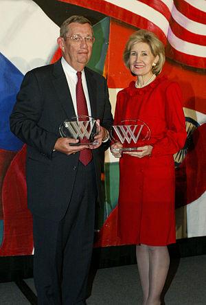 Lee Raymond - Raymond on the left of Kay Bailey Hutchison, both won Woodrow Wilson Awards