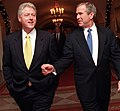 President Bill Clinton and President-Elect George W. Bush walk through the White House (2).jpg