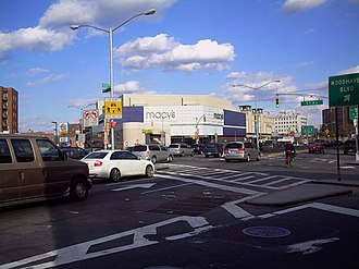 Elmhurst, Queens - The intersection of Queens Boulevard and 57th Avenue; the Macy's store in Queens Center is in the background