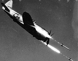 Republic P-47D-40-RE in flight firing rockets.jpg