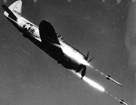 Republic P-47D-40-RE in flight firing rockets