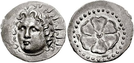 "Silver drachma of Rhodes, 88/42 BC. Obverse: radiate head of Helios. Reverse: rose, ""rhodon"" (Rodon), the symbol of Rhodes. Rhodes 88-42 BC-AD.jpg"