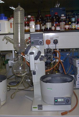 "Rotary evaporator - A Büchi Rotavapor R-200 with ""V"" assembly (vertical water condenser). This modern style instrument features a digital heating bath and a motorised lifting jack. The evaporation flask has been detached."