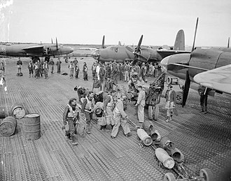 25 Squadron SAAF - SAAF and RAF crews of 25 Squadron SAAF gather by their Martin Marauders at Biferno, Italy as part of the Balkan Air force