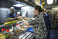 Royal Australian Navy Able Seaman Tricia Armstrong, foreground, gets lunch on the mess decks of the amphibious dock landing ship USS Pearl Harbor (LSD 52) May 26, 2013, in the Pacific Ocean, as the ship transits 130526-N-SP369-024.jpg