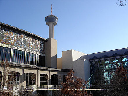 The Henry B. Gonzalez Convention Center and Lila Cockrell Theater along the San Antonio River Walk. The Tower of the Americas is visible in the background. SACC Nima.jpg