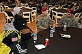 SFC Nelson and Dalessio talk with athletes (8361016601).jpg