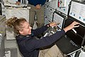 STS-135 Sandy Magnus on the middeck.jpg