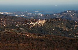 Saint-Cézaire-sur-Siagne viewed from Mons, Var. Cannes is visible in the background with the islands in the bay.