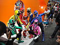 San Diego Comic-Con 2011 - Power Rangers pose with kids (Nickelodeon booth) (5977353490).jpg