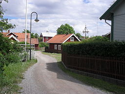 Sandhamn Island - typical street view with a midsommarstång or Midsummer Pole..jpg