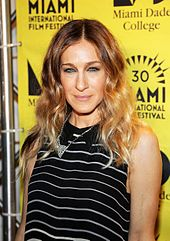 Sarah Jessica Parker in black outfit and wearing a flashy diamond necklace