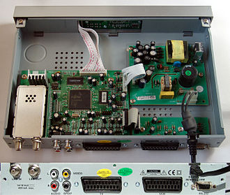 Set-top box - A consumer Palcom DSL-350 satellite-receiver; the IF demodulation tuner is on the bottom left, and a Fujitsu MPEG decoder CPU is in the center of the board. The power supply is on the right.