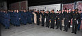 Saudi navy Rear Adm. Dawi Mohammed Saad al-Otaibi, sixth from foreground right, and fellow Saudi naval officers salute with U.S. Sailors and recruits for the playing of the national anthem during a capping 121107-N-IK959-471.jpg