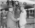 Secretary of War Henry Stimson shakes hands with Gen. Dwight D. Eisenhower as they say good-bye at Mr. Stimson... - NARA - 198845.tif