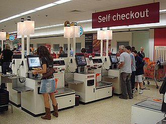 Self-checkout - NCR Corporation model of self-service checkouts and fast-lane at a Sainsbury's store