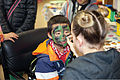 Sho Takata gets his face painted March 30, 2013, during an annual festival celebrating both Easter and the spring season at Combined Arms Training Center Camp Fuji, Japan 130330-M-OY715-601.jpg