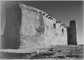 "Side wall and tower with cross, ""Church, Acoma Pueblo. (National Historic Landmark, New Mexico)"" (Misicn de San Estevan - NARA - 519835.TIF"