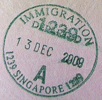 Singapore Changi Airport exit stamp in a passport - 20091213.jpg