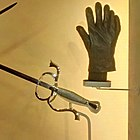 Six-fingered glove and prop sword from the film