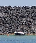 Solidified basaltic lava and boat - Nea Kameni volcanic island - Santorini - Greece - 01.jpg