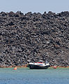 Solidified basaltic lava and boat - Nea Kameni volcanic island - Santorini - Greece - 01.jpg