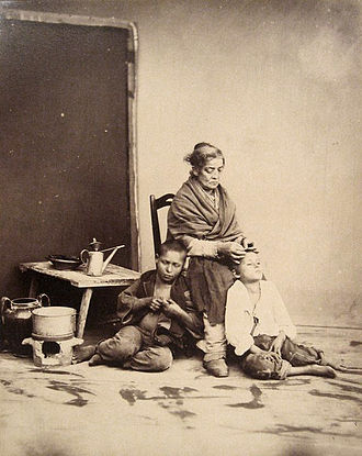 Nitpicking - Photograph by Giorgio Sommer (1834–1914); Famille napolitaine — a Neapolitan mother searching for lice in her son's hair.