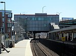South headhouse at JFK UMass station from commuter rail paltform, April 2016.JPG
