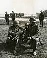 Spanish soldiers learning to handle a machine gun.jpg