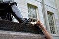 Statue of John Harvard (left foot being rubbed).JPG