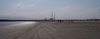 Bull Island - Looking along Dollymount Strand to the SW. The chimneys of the Poolbeg Generating Station are visible in the distance.