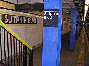 Sutphin Boulevard (IND Queens Boulevard Line) - A mosaic and stair at Sutphin Blvd; an R46 F train is shown at the far right.