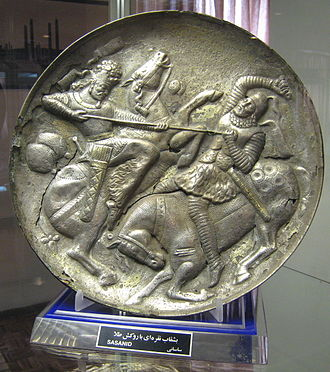 Aswaran - Sasanian silverware, showing a combat between two noble horsemen wearing scale armor, cuirass, chaps, and equipped with kontos, swords, quivers and arrows.