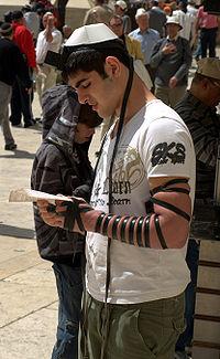 Tefillin worn by a man at the Western Wall in Jerusalem.jpg