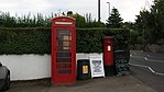 Telephone box and pillar box outside Pool-in-Wharfedale post office.jpg
