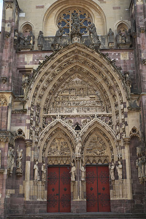 Grand Est - West portal of St Theobald's Church of Thann, a masterpiece of late 14th-century sculpture and architecture.