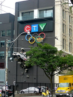 299 Queen Street West - The east side of the building, now featuring a balcony and illuminated CTV signage. The Olympic rings were also added (since removed) below the CTV logo, signifying CTV as official broadcaster of the Olympic Games