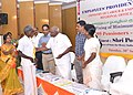 The Minister of State for Heavy Industries and Public Enterprises, Shri P. Radhakrishnan felicitating a pensioner, at a function organised by the Employees' Provident Fund Organisation, in Coimbatore on September 30, 2014.jpg