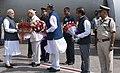 The Prime Minister, Shri Narendra Modi being received by the Governor of Chhattisgarh, Shri Balramji Das Tandon and the Chief Minister of Chhattisgarh, Dr. Raman Singh, on his arrival, at Raipur, Chhattisgarh.jpg