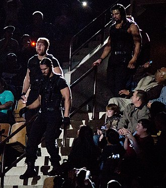 Roman Reigns - Reigns (back) made his WWE debut as a member of The Shield in November 2012