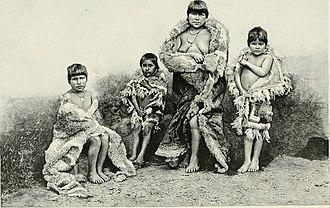 "Alacalufe - ""Alakaluf fuegians, dressed in huanaco skins"" (ca. 1882)."