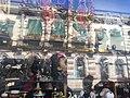Tienda de santos con reflejo de la casa de gobierno de Morelia.jpg