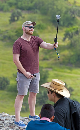 340px-Tourist_taking_selfie_with_stick_a